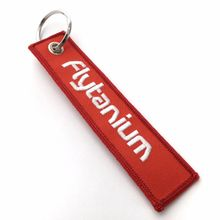 Flytanium  inchRemove Before Flyght inch Tag Keychain